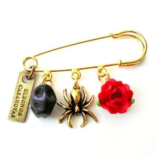 Broche Calavera negra y flor